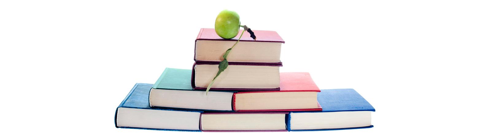 stockvault-apple-on-books128237